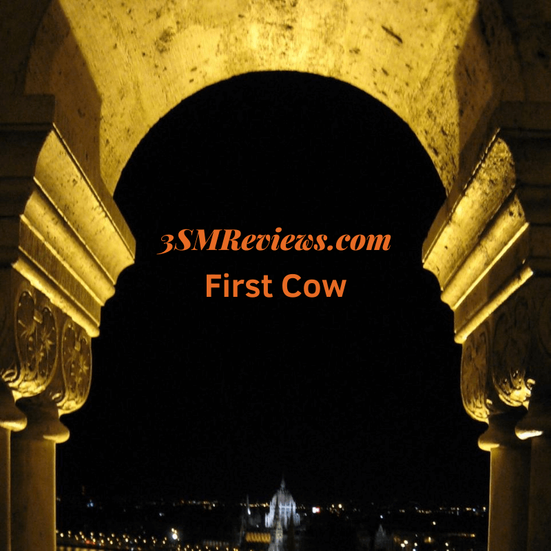 An arch with text that reads: 3SMReviews.com. First Cow.