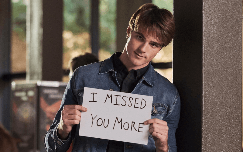 "Picture of Jacob Elordi holding a sign saying, ""I missed you more"" in the Kissing Booth 2"
