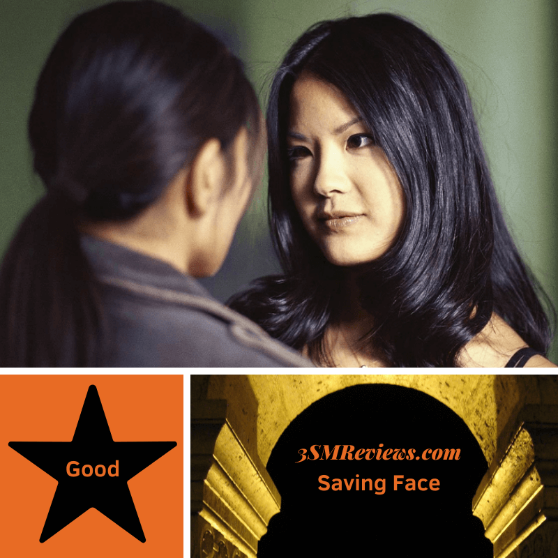 Lynn Chenn looking at Michelle Krusiec in the film Saving Face. A star with text: Good. An arch with text: 3SMReviews.com: Saving Face