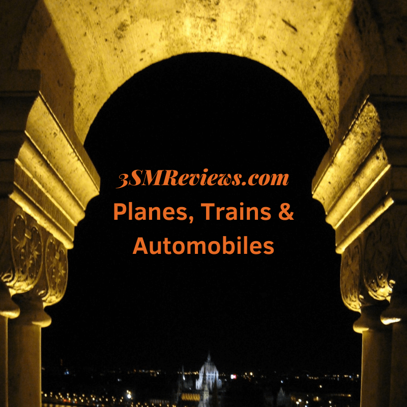 An arch with text that reads: 3SMReviews.com: Planes, Trains & Automobiles